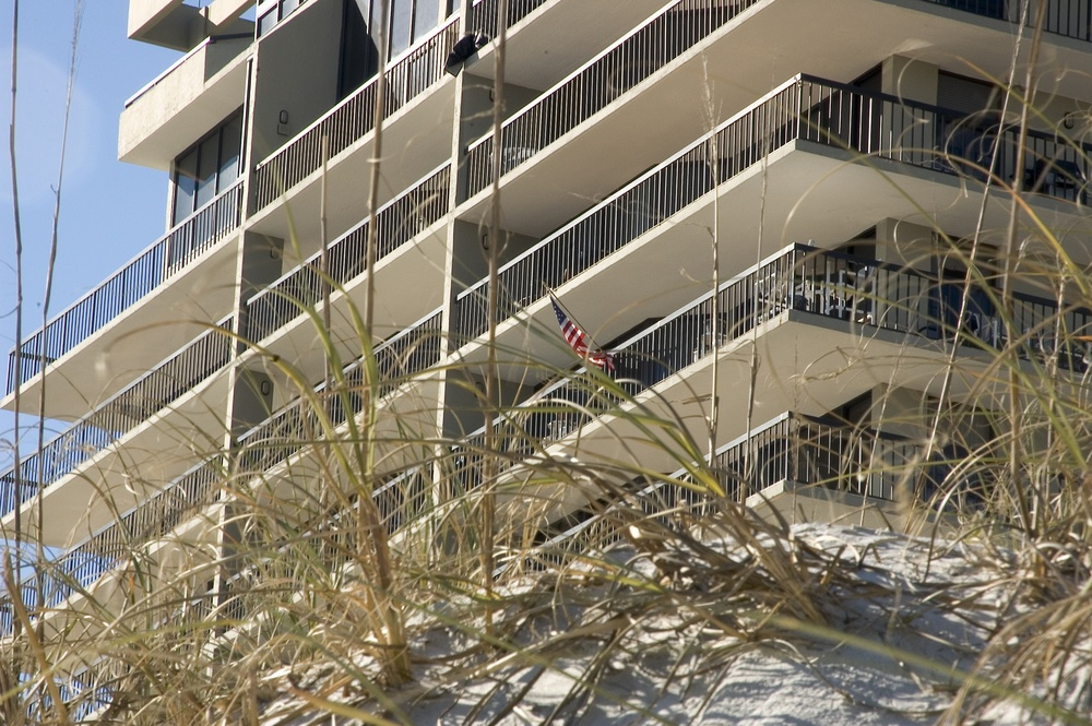 Dune grass and beachfront high-rise-1